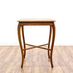This end table is featured in a solid wood with a glossy oak finish. This country style side table has cross-stretchers, sleek curved legs, and a beveled table top. A simple yet elegant table that's perfect for holding a lamp! #countryfarmhouse #tables #endtable #sandiegovintage #vintagefurniture