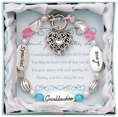 A gorgeous gift for a beloved granddaughter, this bracelet reminds her that she is special and loved by her grandmother. Decorated with silver-plated charms and pink and blue jeweled beads for pops of