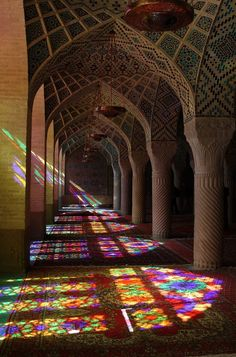 The Nasīr al-Mulk Mosque,a traditional mosque in Shiraz, Iran, located in Goade-e-Araban. The mosque was built during the Qājār era. It was built by the order of Mirza Hasan Ali Nasir al Molk, one of the lords of the Qajar Dynasty, in 1876 and was finished in 1888. The designers were Muhammad Hasan-e-Memar and Muhammad Reza Kashi Paz-e-Shirazi.  The mosque extensively uses colored glass in its facade, and displays other traditional elements such as panj kāseh-i (five concaves) in its design.