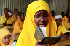 A Somali refugee girl reads the holy Koran at the Liban integrated academy at the Ifo refugee camp in Dadaab, near the Kenya-Somalia border August 2. The United Nations estimates that more than 3.7 million people in Somalia, among them 800,000 children, are on the brink of starvation. The famine in the Horn of Africa is spreading and may soon engulf as many as six more regions of the lawless nation of Somalia, the U.N. humanitarian aid chief said on Monday. (Thomas Mukoya/Reuters) #