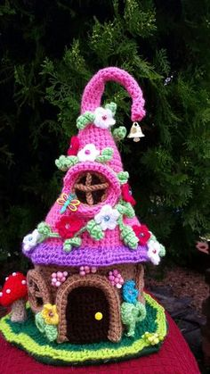 This is a new handmade crochet Fairy/ Gnome house made with acrylic yards. It is decorated on all sides and stands approx. 14 inches tall. This house is