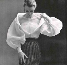 Hubert de Givenchy's white organdy blouse with wide sleeves, deep décoletté is crossed by a modesty fan pleat. Photo Phiippe Pottier, 1952