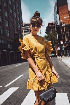The ruffles on the sleeves and trim give the dress a more fun look. It can be worn for brunches or small outings by women of many ages. The colour is bright and appropriate for spring season.
