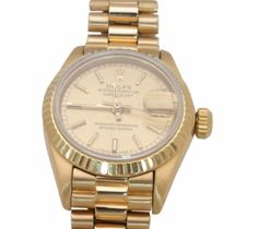 Lady's Rolex Wrist Watch  Lady's Rolex 18K Yellow Gold date-just Wrist Watch, non-quick set, champagne dial,  Ref. #8570F. Like new with box. One year guarantee on the movement only! Item Number: WOO629