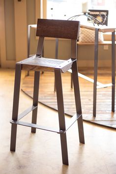 This rustic counter height stool has a great minimalist design that matches any contemporary environment. Order this metal and reclaimed wood bar stool today! Bar Stools With Backs, Wood Bar Stools, Counter Height Stools, Iron Furniture, Furniture Making, Car Furniture, Wrought Iron Chairs, Office Chair Without Wheels, Wall Racks