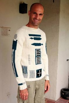 This is the droid you're looking for! A knitted R2-D2 raglan-style sweater, handmade by Etsy seller EricaKnit, custom-made to order as per your measurements. The perfect fitting sweater is so hard to find, and as a super Star Wars geek myself, this is uber-fantastic! This sweater is for men OR women. It is fitted because it is naturally stretchy, and has a raw rolled edge collar for a more urban look