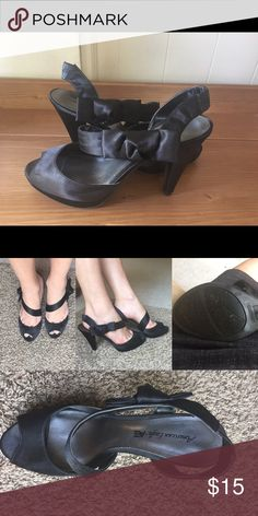 Black satin pumps with side bow American Eagle black satin pumps, hardly worn and in good condition - I wear a wide 8.5 and these are a little too narrow even though they are marked as a 9!! American Eagle by Payless Shoes Heels