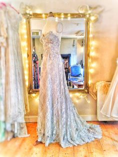 Joanne Fleming Design: Halcyone; a flower embellished lace and silk wedding gown in tranquil French grey