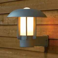 Exterior wall lantern with soft curves and smooth lines. Available in smart lacquered aluminium or matt black and with a 2 year warranty. Garden Exterior Lighting, Exterior Wall Light, Outdoor Wall Lighting, Outdoor Walls, Led Außenstrahler, Garden Wall Lights, Home Lighting Design, Wall Light Fixtures, Wall Lantern