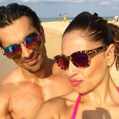 Looks like the lovebirds had an awesome time celebrating the #NewYear on the sand. #BipashaBasu and #KaranSinghGrover rock the selfie with their eye-catching shades on!