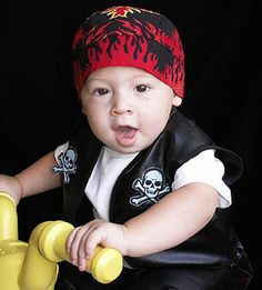 Biker Baby:  Either buy a baby black vinyl vest, or cut your own from a black shirt. Sew on some skull and cross bones patches and add a scary skullcap. Let your little one trike his way through trick-or-treating to get the full biker effect.