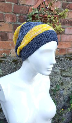 Made to Match our Vintage Hufflepuff, Newt scamander, Harry Potter inspired Scarves, this beanie/ slouchy style hat follows the irregular 2 stripe style of the scarf. Main colours of mustard, faded yellow and Grey mix set the style of this fashionable, warm, winter, wooly,  These hats are made to order and generally made to fit a standard 21/22 inch head, ( but they can be made bigger or smaller on request) ask me about it!  typical slouchy beanie hat. perfect for watching your favourite…