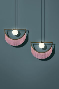 Spanish creative agency Masquespacio worked with Houtique, a new branch of Really Nice Things, on a pendant light that resembles an eye winking.