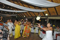 Bride throwing the bouquet to the single ladies! lovely action