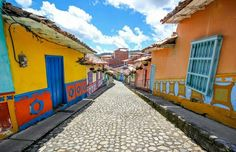Stunning images show world's most colourful town Guatape in Colombia where every single building and street is covered in brightly coloured paint Scenery Photography, Street Photography, Most Visited Sites, Family Painting, South America Travel, Places Around The World, Image Shows, National Geographic, Fresco