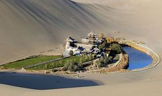 China - Sand dune & the Moon Crescent Oasis in Xinjiang