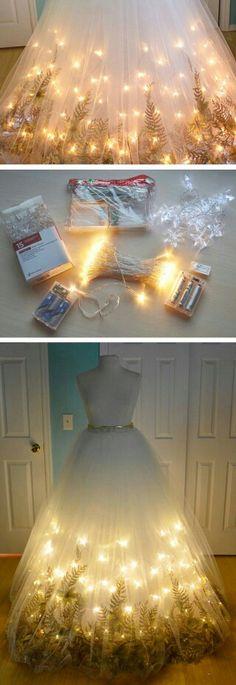 Ik vind de jurk in combinatie met de lichtjes en het groen heel er mooi…
