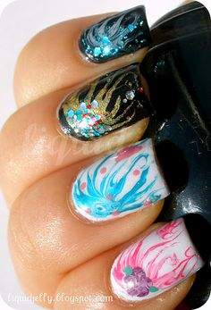 Needle Marbling Nails Tutorial - I have got to try this.  Very cool!  There is a video on the site too.