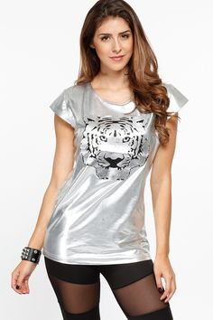 Check out the retro chic material! It features a metallic silver stretch material, cap sleeve, and tiger cut out print on the center front. This top is perfect for a stand out look just add your favorite leggings and flats.  Exclusively at www.cicihot.com #america #cute #platform #patriotic #lace #sneaker #zipper #easyslipin #weheart