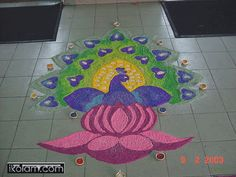http://www.ikolam.com/files/imagecache/rangoli-big/private/active/0/peacock_in_lotus.gif