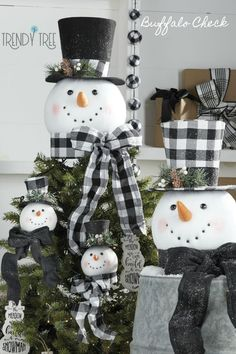 Huge snowman head with top hat. Either with Buffalo check top hat or plain black decorated with buffalo check. Coming soon to Trendy Tree. See more of this RAZ Christmas in the Country collection at Trendy Tree. Products start arriving for 2019 in July! #trendytree #buffalocheck #razchristmasdecor