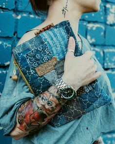 Love the clutch. Don't like the tattoo.