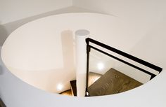 Set in a West Village loft, this spiral staircase is a striking example of how beautiful small and minimal can be. Designed by Daniel Frisch Architecture.