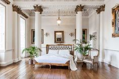 Bedroom Design Ideas - Colonial Chic tropical trend  This grand room combines elegat colonial decor in breezy white shades with gold touches.