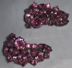 Weiss Pink Fuchsia Rhinestone Climber Earrings. Weiss vintage earrings feature marquis, emerald cut and round rhinestones in pink fuchsia color. Stones are prong set in silver rhodium backs. Excellent sparkly brilliant stones. Clip on earrings. Circa: 1950.
