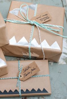 Simple and cheap holiday gift wrapping using Kraft paper, bakers twine and paper cutouts
