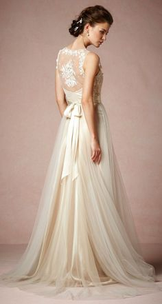 I love the ease and flow of the tulle and the elegant lace back