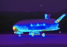 VANDENBERG AIR FORCE BASE, Calif. (AP) — A top-secret space plane landed Friday at an Air Force base on the Southern California coast.