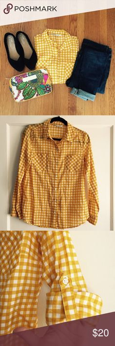 Yellow Gingham Buttoned down Top  This is a great Old Navy women's top in a amazing super flattering Yellow!  It is a women's MED.  It comes with the ability to fold the sleeve 3/4.  Has only been dry cleaned and comes from a pet and smoke free home.  Feel free to ask any questions!  Happy Poshing! Old Navy Tops Button Down Shirts