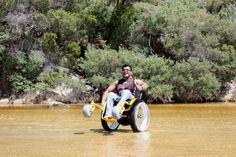 Judeland Anthony using a beach wheelchair
