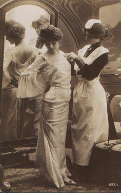Edwardian Woman with Maid dressing her
