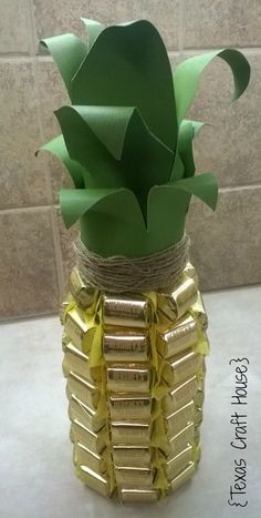 {Texas Craft House} Champagne bottle pineapple. You could use any gold chocolates to cover a champagne bottle or wine bottle.