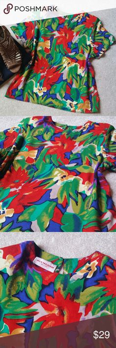 "*Jack Mulqueen Floral Print Top* *Great Condition!! Gorgeous floral print top with a vintage feel. Shoulder pads. Minor thread run (Pic. 6). Key hole back. Sz Medium (May fit closer to Small). Length: 22.6"", Pit-to-Pit: 19"". 100% Rayon. Ask any questions. Happy Poshing!!* Jack Mulqueen Tops"