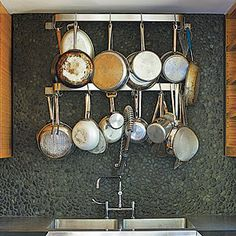 Genius! Hang a rack over the sink to allow just-washed pots to drip-dry. | CookingLight.com