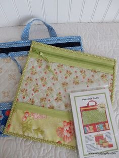Project Bags with vinyl front, zippered. Fabric piece panel at bottom. Zipper at top, binding. back is quilted. heavy weight vinyl; Four sizes: 6x10, 10 x 12, 13 x 13, 16 x 16; pattern by Annie Unrein at https://www.byannie.com/shop/product/project-bags/