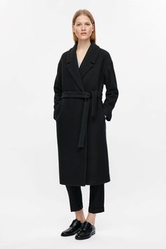 COS image 1 of Belted wool coat in Black