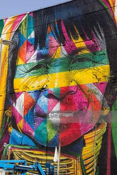 """Graffiti panel """"Ethnicities"""" (Etnias) with 3000 square meters receives finishing touches and will be opened in the coming days on Olympic Boulevard in Rio de Janeiro. The author of gratitti is the artist Eduardo Kobra and completion of the work he has a team of 12 artists. Once completed, the panel will be one of the main attractions in Olympic Boulevard, where will the Olympic Pyre. In place various cultural events occur."""