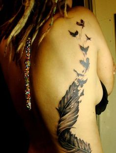 38 feather birds rib tattoo for girls - 50 Rib Tattoos for Girls