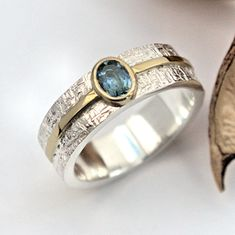 Aquamarine silver and gold ring