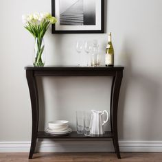 The Anjelle contemporary sofa table is the finishing touch to all decor! It features a curvy appealing style with a single open shelf unit and is elegantly supported upon flared sturdy legs. Perfect against the sofa, hallway or entryway.