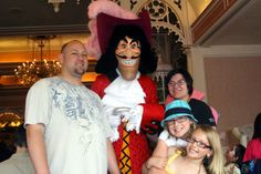 My brother, my nieces and I with Captain Hook at the character breakfast at Plaza Inn at Disneyland on 6/9/2010. By Tierny Garrison.