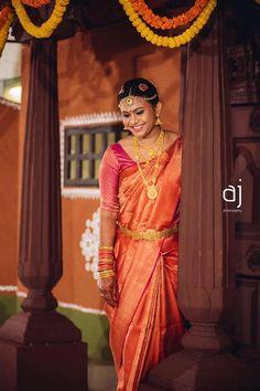 Traditional Southern Indian bride wearing bridal silk saree and jewellery. Muhurat look. Makeup and hairstyle by Vejetha for Swank Studio.  Photo credit: AnbuJawahar Photography.  #BridalSareeBlouse #SariBlouseDesign #maangtikka #templejewellery Silk kanchipuram sari. Tamil bride. Telugu bride. Kannada bride. Hindu bride. Malayalee bride  Find us at https://www.facebook.com/SwankStudioBangalore