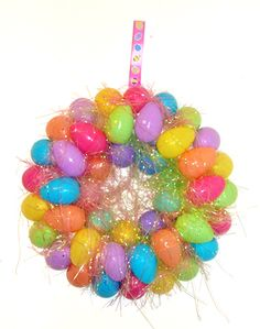 Easter Egg Wreath - So easy to make the kids can do it! http://we-made-that.com/easter-egg-wreath/