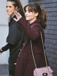 Lovely Jenna Coleman, in a purple coat that I'm drooling over.