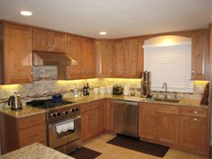 The Mendota kitchen cabinet door style in a Maple Caramel finish from CliqStudios.    http://www.cliqstudios.com