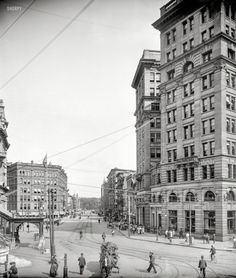 """Syracuse, New York, circa 1904. """"Genesee Street."""" Early-1900s standbys include the usual assortment of painless dentists, and a """"Misfit"""" clothing parlor. 8x10 inch dry plate glass negative, Detroit Publishing Company."""